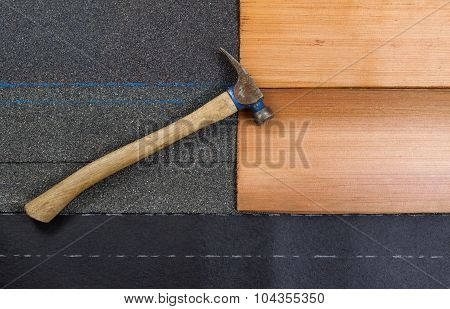 Used Roofing Hammer With New Shingles Of Composite And Cedar Wood On Felt Paper