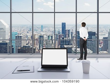 A Dressed Person In Formal Clothes Is Standing In Modern Panoramic Office And Looking At New York. A