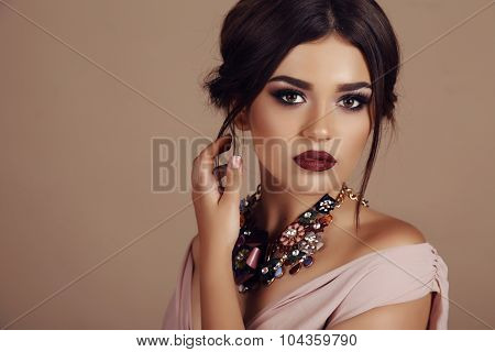 Young Woman With Elegant Hairstyle And Luxurious Necklace