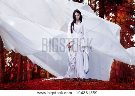 Hero of Eastern philosophy. Asian woman in white kimono holding samurai sword