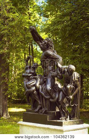 Bronze sculpture nude men with a snake in Oranienbaum