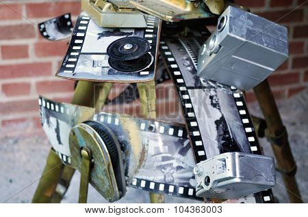 Old Film Movie Camera With Fragments Of Film Frames In The Span Of Novgorod Kremlin Fortress.