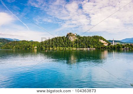 Bled Castle At Bled Lake In Slovenia Reflected On Water