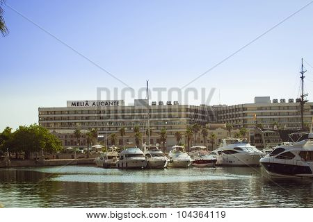 A boats stands on the dock at the waterfront Alicante