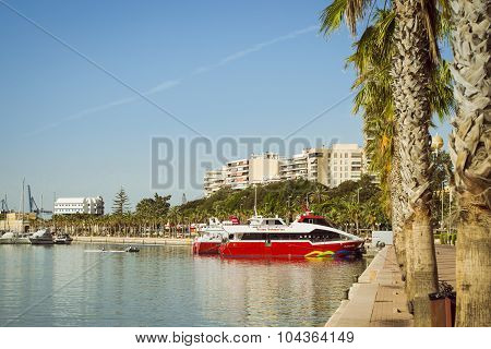 A boat Vision stands on the dock, Alicante, Spain