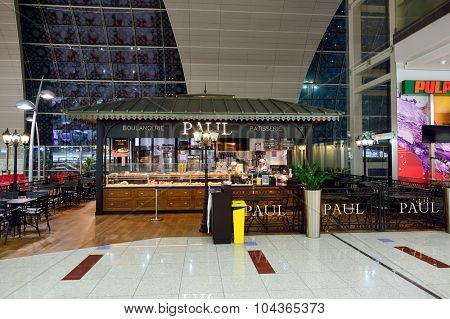 DUBAI, UAE - SEPTEMBER 08, 2015: Paul cafe in Dubai Airport. There are a lot of restaurants, bars, cafes and shops in Dubai International Airport. Almost all of them are open twenty-four hours.