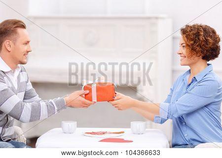Pleasant man giving present