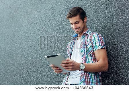 Young Modern Man Using Digital Tablet