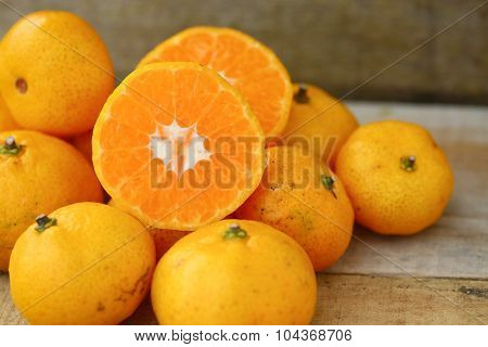 Fresh orange on wooden table in dining room. Healthy fruit for lose weight ,Fresh oranges on wooden