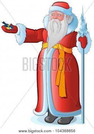 Russian Santa Claus feeds the bird titmouse