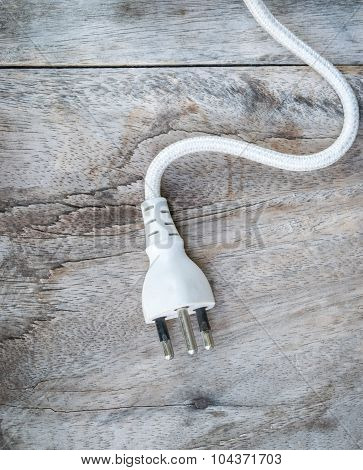 Electric Plug Cable  On Wooden Background