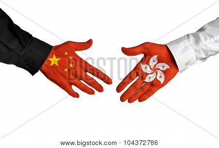China and Hong Kong leaders shaking hands on a deal agreement