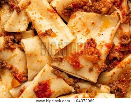 rustic italian pasta in ragu sauce food background