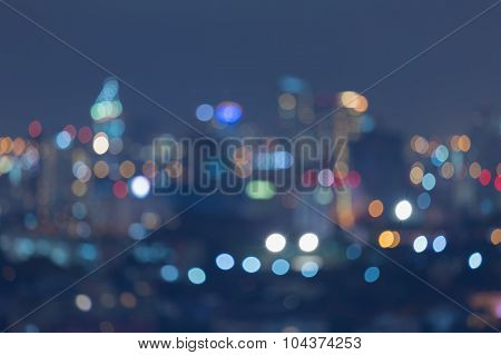 Abstract blurred bokeh multiple colours office building lights view at night