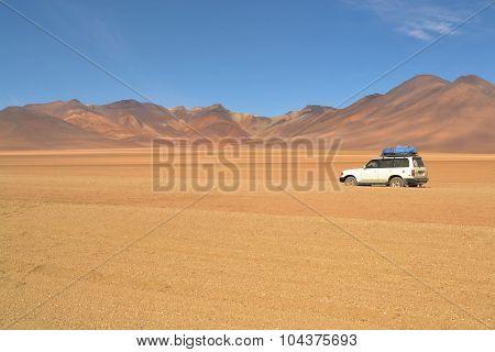 ourist jeep in Dali desert of Southwestern Bolivia near Uyuni