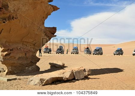 Tourist Jeeps stop at rock formations in Southwestern Bolivia near Uyuni