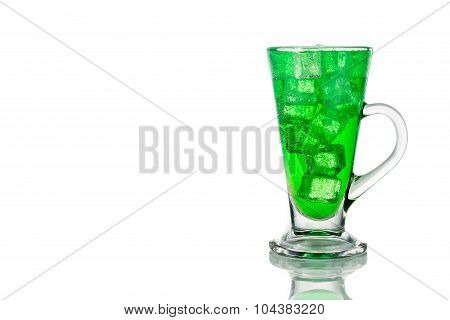 Refreshing Green Fizzy Soft Drink With Ice In Transparent Glass