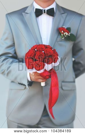 Beautiful Groom Holding Red Wedding Bouquet Flowers