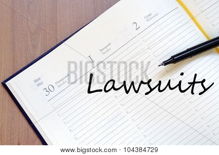 Lawsuits write on notebook
