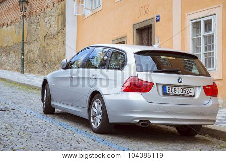 The car BMW station wagon on the street Mala Strana Prague's