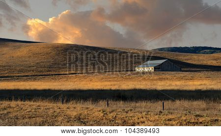 Beautiful Image of Early Morning Barn with growing fields