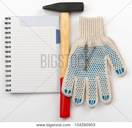 Copy book with hammer and gloves