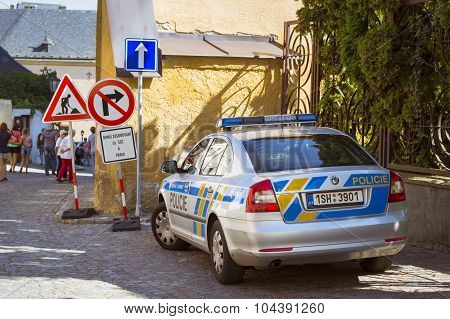 A police car of brand Skoda in the charming street with old hauses in Kutna Hora
