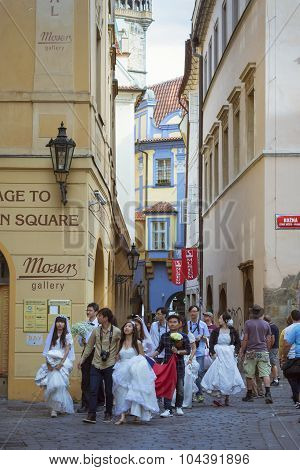 Asian wedding brides and grooms in the old town of Prague