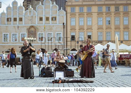 Musicians with folk instruments on old Town Square Prague