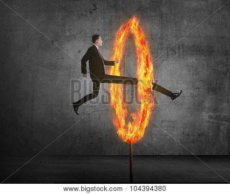 Long Leg Asian Business Person Jumping Through Ring Of Fire