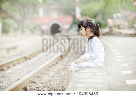 Lonely Asian Girl On The Train Station