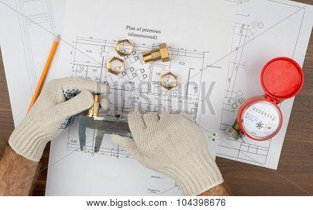 Mans hands in gloves holding trammel