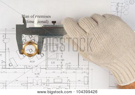 Mans hand in glove holding trammel