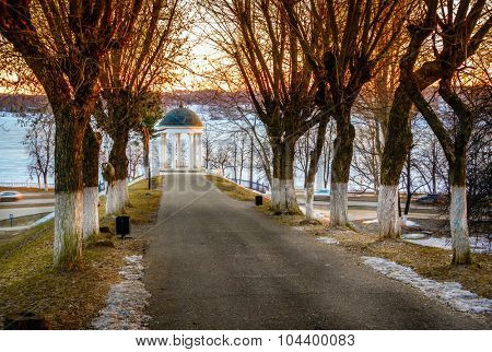Scenic alley and the traditional Russian pavilion on the shore of the Volga River in Kostroma, Russia