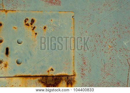 surface of rusty iron with remnants of old paint background