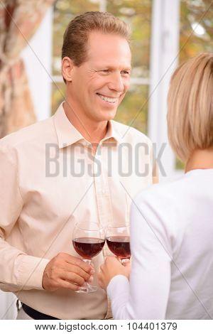 Pleasant couple drinking wine