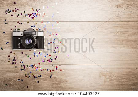Slr Camera On A Wooden Background