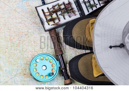 Fishing Tackles And Shoes On Paper Map