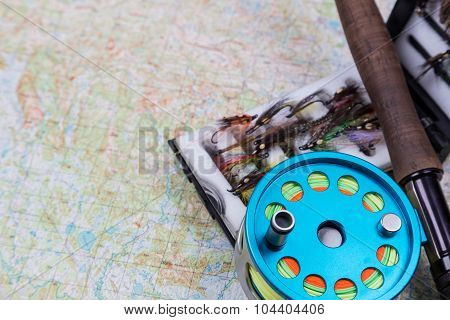 Fishing Journey With Fly-fishing Tackles And Map