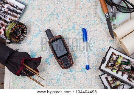 Fly-fishing Tackles On Paper Map Background