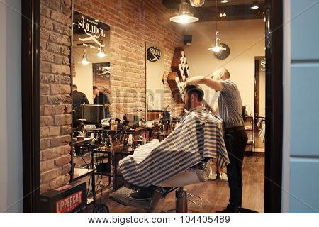 LVIV, LVIVSKA/UKRAINE - OCTOBER 08: Hairdresser In Process Of Work