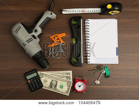 Drill with money and tape measure