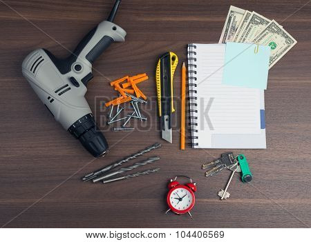 Drill with money and keys