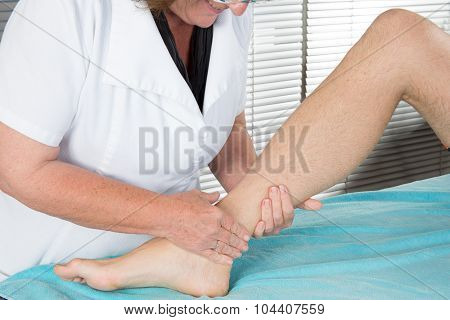 Close Up Of Physiotherapist Massaging Female Foot