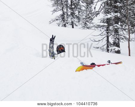 Snowboarder In A Snow Drift