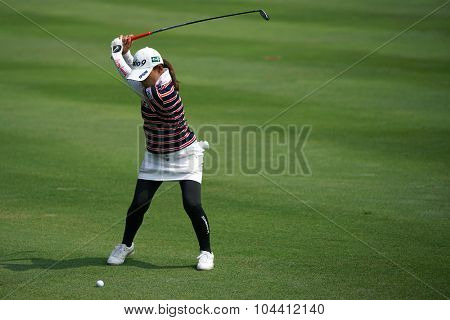 KUALA LUMPUR, MALAYSIA - OCTOBER 09, 2015: Japan's Sakura Yokomine plays her shot from the sixth hole fairway of the KL Golf & Country Club at the 2015 Sime Darby LPGA Malaysia golf tournament.