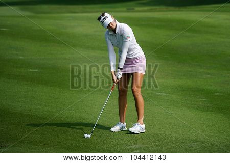 KUALA LUMPUR, MALAYSIA - OCTOBER 09, 2015: USA's Jessica Korda plays from 6th hole fairway of the Kuala Lumpur Golf & Country Club at the 2015 Sime Darby LPGA Malaysia golf tournament.