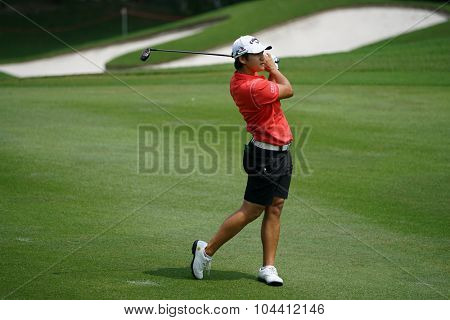 KUALA LUMPUR, MALAYSIA - OCTOBER 09, 2015: Taiwan's Yani Tseng checks the sixth hole fairway of the Kuala Lumpur Golf & Country Club at the 2015 Sime Darby LPGA Malaysia golf tournament.