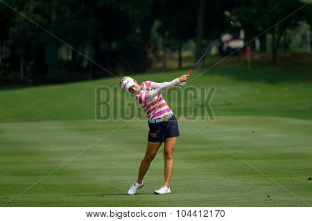 KUALA LUMPUR, MALAYSIA - OCTOBER 09, 2015: South Korea's Chella Choi plays her shot from the sixth hole fairway of the KL Golf & Country Club at the 2015 Sime Darby LPGA Malaysia golf tournament.