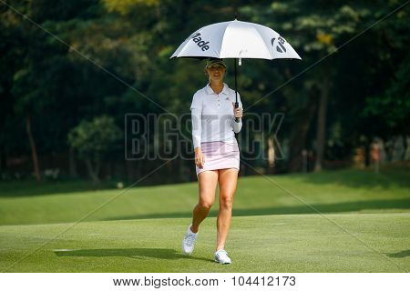 KUALA LUMPUR, MALAYSIA - OCTOBER 09, 2015: USA's Jessica Korda walks on the sixth hole fairway of the Kuala Lumpur Golf & Country Club at the 2015 Sime Darby LPGA Malaysia golf tournament.